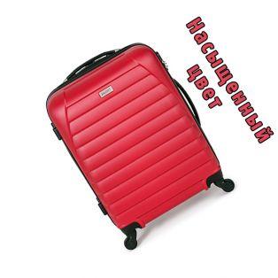 Пластиковый чемодан на четырех колесах малиновый