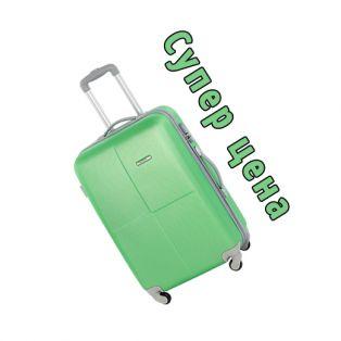 Пластиковый чемодан на четырех колесах нефритовый