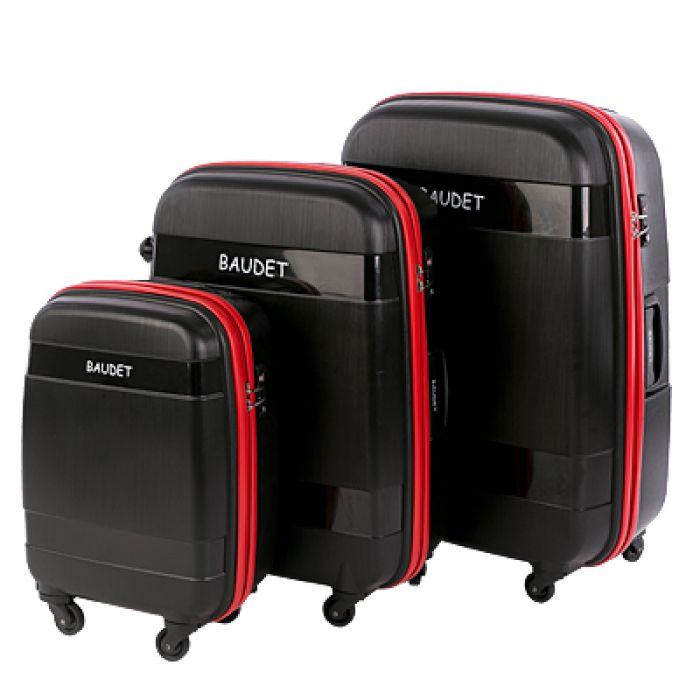 Пластиковый чемодан на четырех колесах черный с красной молнией