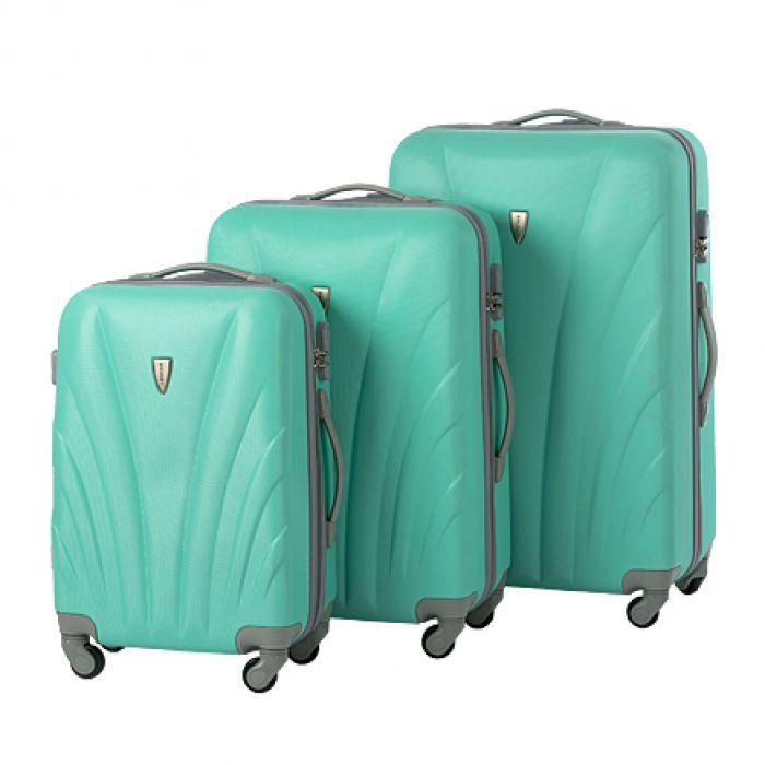 Пластиковый чемодан на четырех колесах бирюзовый жемчуг