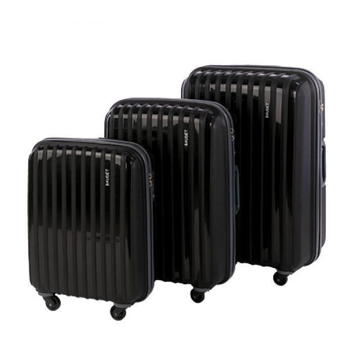 Пластиковый чемодан на четырех колесах антрацитовый