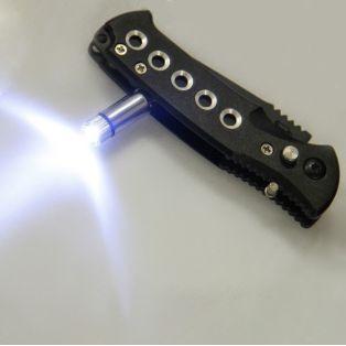 """Складной нож, лезвие """"drop-point"""" с зазубринами 6 см, с фонариком, черный"""