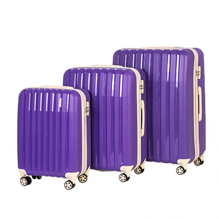 Пластиковый чемодан на четырех колесах индиго