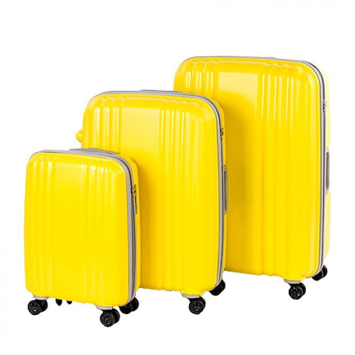 Пластиковый чемодан на четырех колесах сочно-лимонный